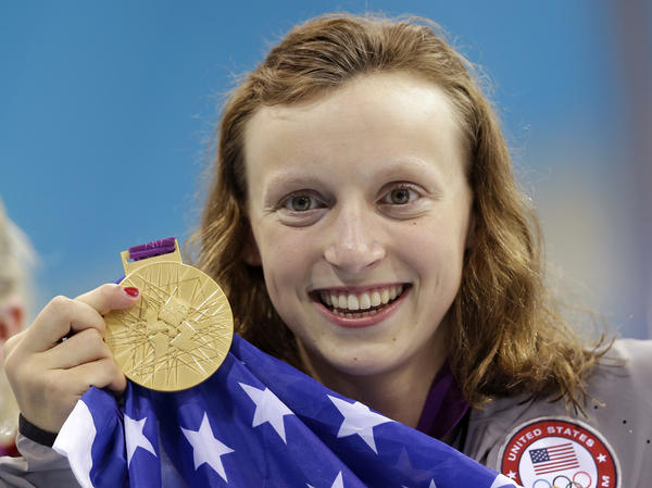 U.S. swimmer Katie Ledecky holds up her gold medal after winning the women's 800-meter freestyle swimming final at the Aquatics Centre in the Olympic Park during the 2012 Summer Games in London.