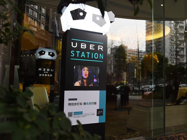 An Uber Station is shown outside a hotel in Chengdu, in southwest China's Sichuan province. Uber spent $1 billion in China last year, but only got a share of around 10 percent, compared to Didi Chuxing's more than 80 percent.