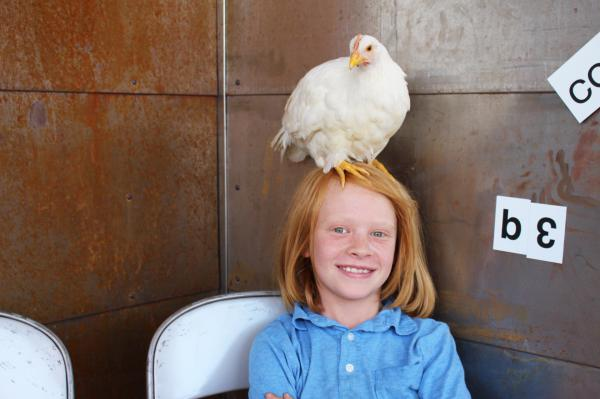 Leopold Simmons with his Leghorn, Dove.