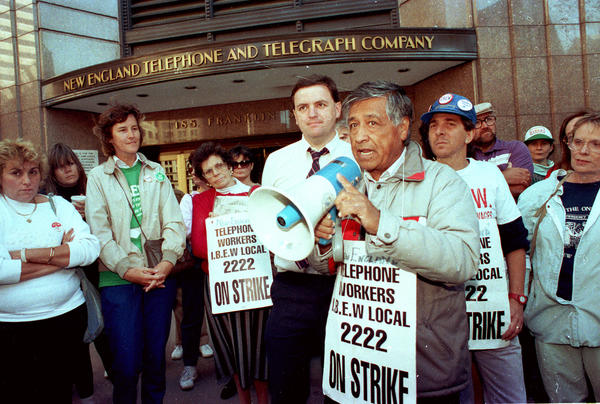 Chavez speaks to striking telephone workers outside the New England Telephone and Telegraph Company headquarters in Boston on Oct. 13, 1989.