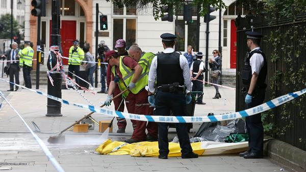 The crime scene in London's Russell Square is cleaned Thursday morning, following a knife attack late Wednesday in which one woman was killed and five others injured.
