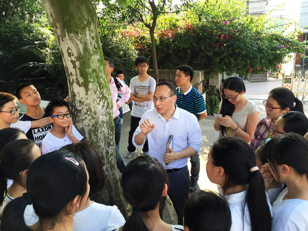 Zhang Liang, a reformist educator and social entrepreneur, talks to students after class at Cold Water Well Middle School. Zhang advocates breaking down the traditional course structure, and restructuring education around the needs of the students.