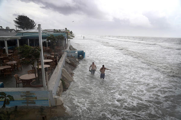 Tropical Storm Colin brought big waves to Fort Myers Beach in Fort Myers, Fla., in early June. Given the threat of serious flooding, Gov. Rick Scott declared a state of emergency in the area.