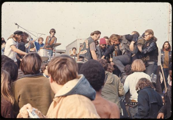A Hells Angel stomps on an attendee at the Altamont Free Concert at Altamont Speedway in northern California on Dec. 6, 1969. (Courtesy of Beth Bagby)