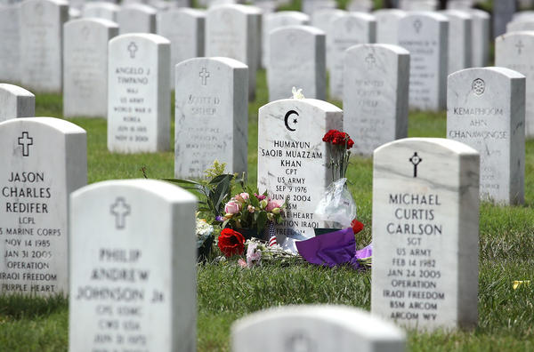 The gravesite of U.S. Army Capt. Humayun Khan is shown at Arlington National Cemetery on Monday in Arlington, Va. Khan was killed during Operation Iraqi Freedom in 2004. Khan's mother and father, Ghazala and Khizr Khan, were criticized by Republican presidential candidate Donald Trump after their appearance onstage at the Democratic National Convention in Philadelphia.