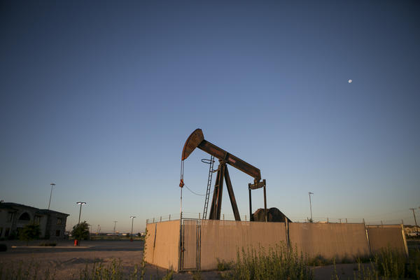 Pump jacks dot the landscape outside Midland, a West Texas oil town.