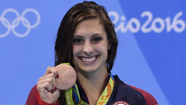 USA's Katie Meili poses with her bronze medal on the podium of the women's 100-meter breaststroke at 2016 Olympic Games in Rio.