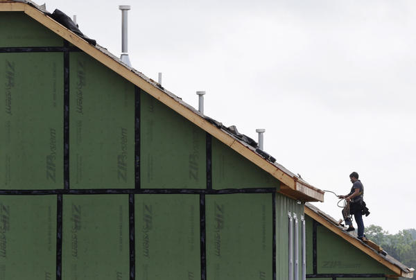 A roofer works on a home in Chapel Hill, N.C.  A rebound in spending on home remodeling is a good sign for the U.S. economy. But a shortage of skilled workers is restraining activity.