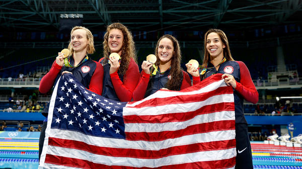 Gold medalists, left to right, Katie Ledecky, Allison Schmitt, Leah Smith and Maya DiRado of the United States pose on the podium during the medal ceremony for the women's 4 x 200 meter freestyle relay final Wednesday.