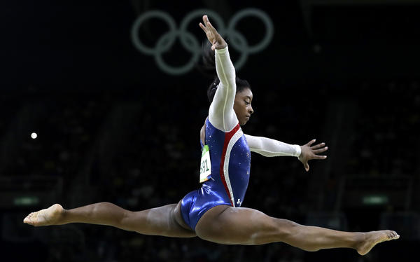 Simone Biles performs on the balance beam in the individual all-around final on Thursday in the Rio Games. Biles won gold and teammate Aly Raisman took the silver.
