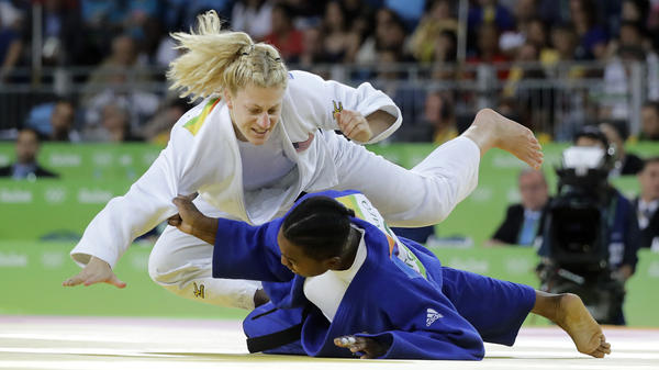 Kayla Harrison of the United States (in white) defeated France's Audrey Tcheumeo in the women's 78 kg judo gold medal match on Thursday in Rio. Harrison, the only American to win a gold in judo, successfully defended the title she won in London four years ago.
