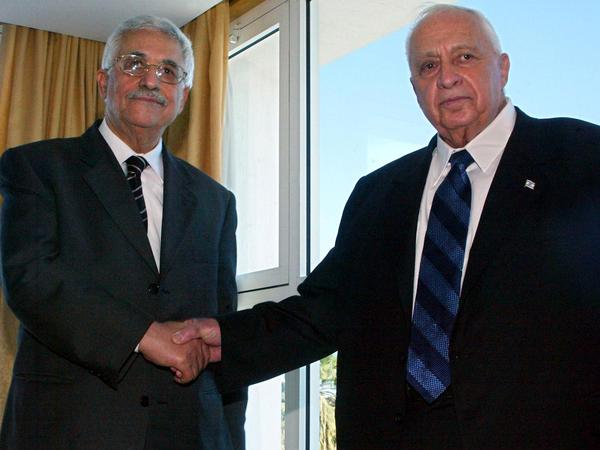 Palestinian leader Mahmoud Abbas (left) and Israeli Prime Minister Ariel Sharon shake hands before their summit meeting in Sharm El-Sheikh, Egypt, on Feb. 8, 2005. Abbas and Sharon declared a cease-fire to end four years of deadly violence. Since then, there have been long periods of low-level violence, punctuated by brief, intense bouts of killing.