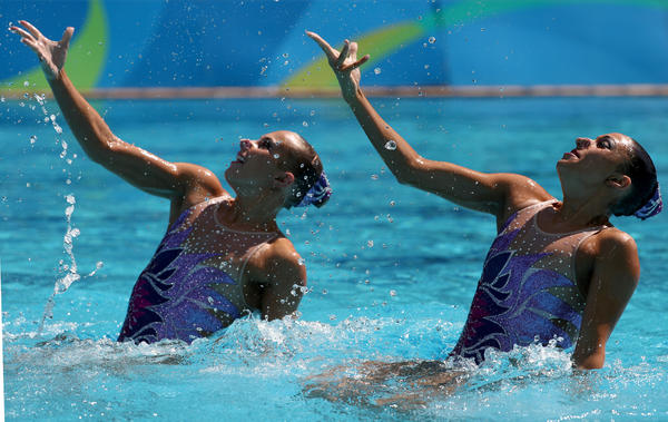 Anita Alvarez and Mariya Koroleva compete in the women's duets synchronized swimming technical routine preliminary on Monday in Rio de Janeiro. Koroleva has suffered several concussions over the years.