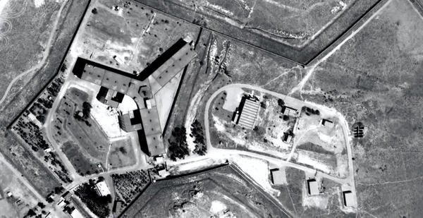 Saydnaya military prison is located about 19 miles north of Damascus, Syria. Amnesty International says the prison is under the jurisdiction of the Minister of Defense and operated by the military police.