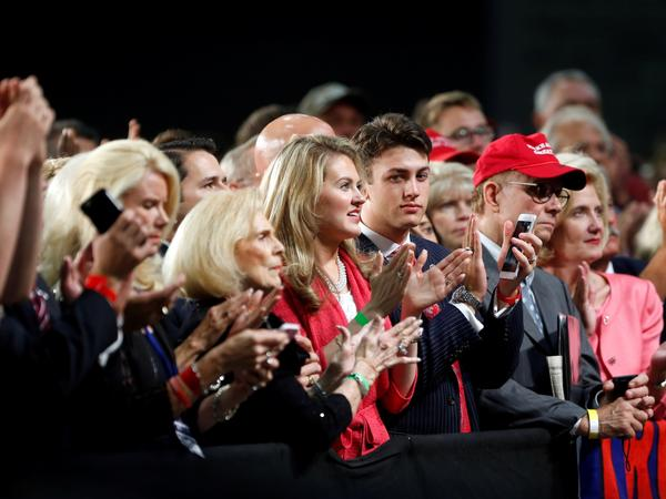 The audience reacts as Republican presidential candidate Donald Trump delivers a campaign speech in Charlotte, N.C., Thursday.