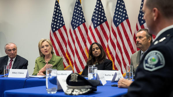 Sitting between New York City Police Commissioner Bill Bratton and policy adviser Maya Harris, Democratic presidential candidate Hillary Clinton speaks during a meeting with law enforcement officials earlier this week in New York City.