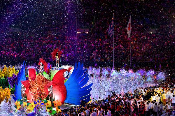 Confetti falls as singers and dancers perform during the closing ceremony on Sunday.