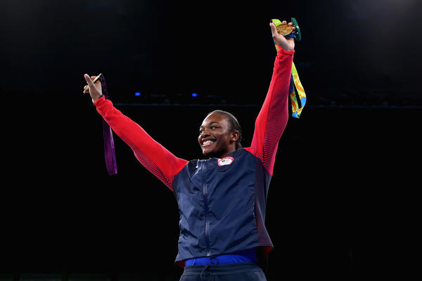 Boxer Claressa Shields holds her gold medals from the 2012 and 2016 Olympic Games during the medal ceremony on Sunday. She is the first U.S. boxer to win consecutive Olympic gold medals.