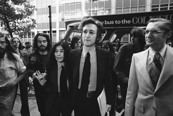 Yoko Ono, John Lennon and their immigration attorney, Michael Wildes (right), leave the Immigration and Naturalization Service in New York City on March 16, 1972.