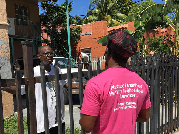 Lenroy Watt talks with residents of Miami's Little Haiti about Zika, leaving brochures in Creole about how to prevent the illness, as well as phone numbers for local mosquito control agencies and the county health department.