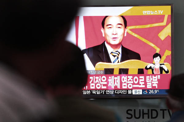 South Koreans watch TV news showing a file image of Thae Yong Ho, a minister at the North Korean Embassy in London who recently defected to South Korea.