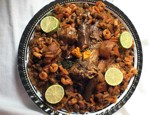 Jollof rice likely originated in Senegal. But Senegal's as-good-as-national dish is <em>thiebou dieun</em>, a mix of rice, fish and vegetables that — except for red rice — bears little resemblance to what the rest of West Africa calls jollof. This tempting-looking plate of <em>thiebou dieun royal </em>was prepared by my Senegalese friend Adja Ba.