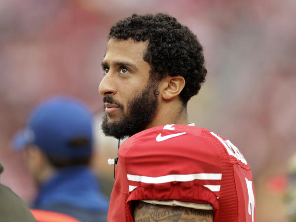 San Francisco 49ers quarterback Colin Kaepernick stands on the field during an NFL game against the Atlanta Falcons in Santa Clara, Calif.