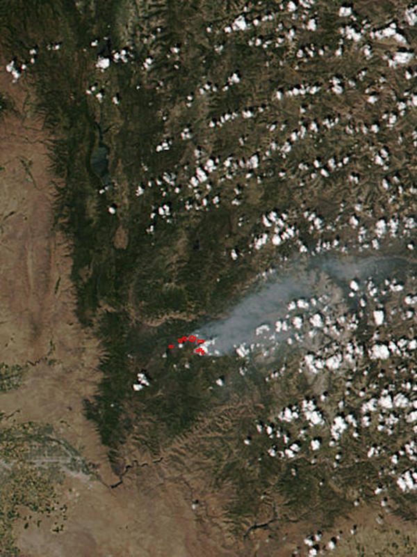 A NASA satellite image captured July 28 shows the smoke plume from the Pioneer Fire. The blaze is 13 times larger now.