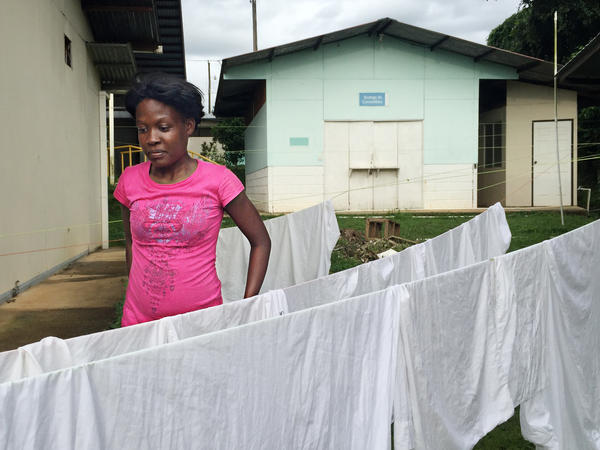 A migrant, who says she's from the Congo, hangs out laundry at a shelter in southern Costa Rica. In the past four months, more than 6,500 migrants have been registered entering Costa Rica along its southern border. Most say they are from Africa and Southeast Asia, but authorities believe the majority are from Haiti.