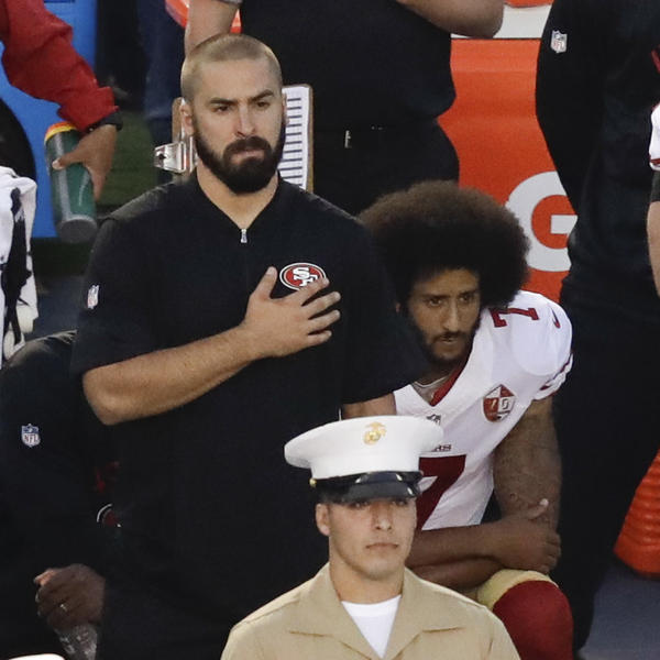 Colin Kaepernick, quarterback of the San Francisco 49ers, kneels during the national anthem before Thursday night's game in San Diego.