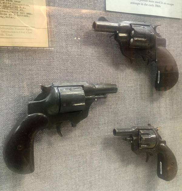 Realistic-looking wooden pistols carved and painted by an inmate at the Walls Unit prison in Huntsville, Texas, in 1964. They were intended to be used in an escape attempt but were discovered by employees of the prison.
