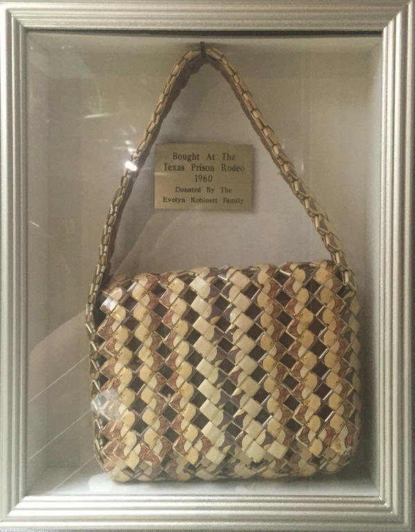 A convict made this purse out of Camel cigarette packages. Tobacco had been sold in prison commissaries but was banned in 1995.