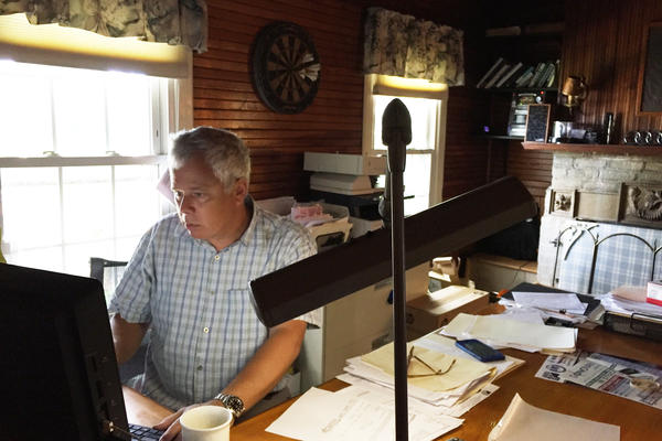 Rob Goldman, co-owner of the New York State Marine Highway Transportation Company, works in his office in Troy, N.Y.