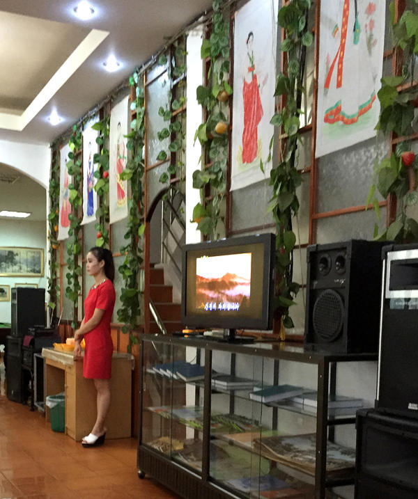 A waitress at Pyongyang Restaurant in Vientiane was able to speak Korean, a little Lao and Mandarin Chinese. Jobs outside North Korea like these are highly coveted, but also considered by human rights groups as a form of slave labor, as workers don't keep the majority of their wages and are under strict supervision.