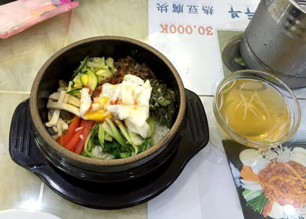 Traditional Korean <em>dolsot bibimbap,</em> as served at Laos' Pyongyang Restaurant.