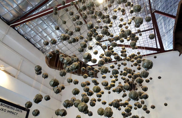 """An exhibit of """"bombies,"""" or cluster submunitions, at the visitor center for the nonprofit COPE. An estimated 30 percent of bombs dropped on Laos by U.S. forces during the Vietnam War failed to explode, so they continue to cause casualties today."""
