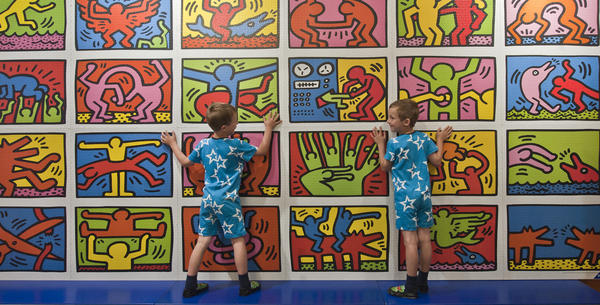 Children complete a jigsaw puzzle of Haring's art during a photocall at Hamleys toy store in London in June 2013.
