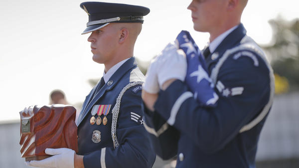 The U.S. Air Force Honor Guard carries the remains of World War II pilot Elaine Harmon during services on Wednesday at Arlington National Cemetery in Arlington, Va.