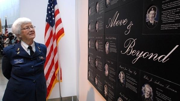 """Elaine D. Harmon, a former pilot of the Women Airforce Service Pilots program, walks through the """"Fly Girls of World War II"""" exhibit in 2008 at the Women in Military Service for America Memorial in Arlington, Va. Harmon was laid to rest at Arlington National Cemetery on Wednesday."""
