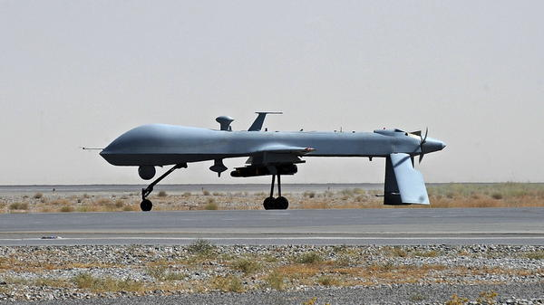 A U.S. Predator drone sits on the tarmac at the Kandahar military airport in southern Afghanistan in 2010. The U.S. has been using drones more and more frequently since the Sept. 11 attacks. They have been highly effective on the battlefield, but have raised legal and ethical issues.