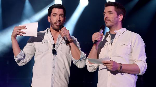 Hosts Jonathan Scott and Drew Scott of HGTV's <em>Property Brothers</em> speak onstage during CMA Festival on June 10.