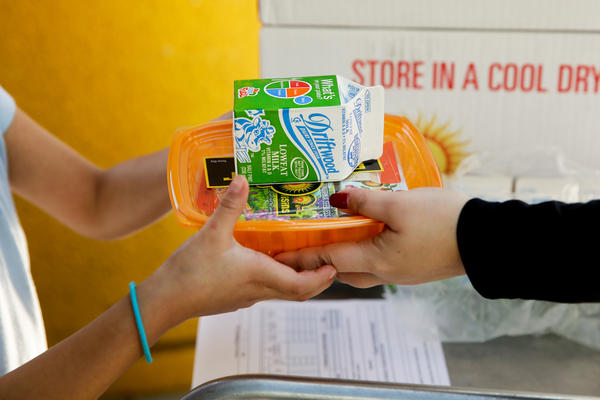 A student receives her afternoon snack at Kingsley Elementary School in Los Angeles. Many of the students at the school in a low-income neighborhood of Los Angeles eat breakfast and lunch provided by the school.