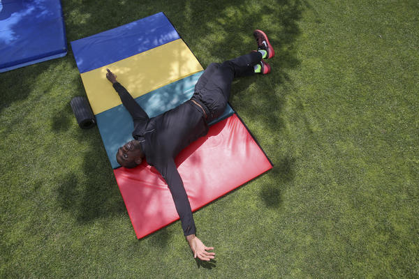 """Gillette stretches during practice. """"I was kind of enclosed by people's expectations,"""" Gillette says. """"But when I'm on the track and I'm running down the runway by myself and jumping into the air, it's like someone opens up this cage door and I'm able to go out and be free and do my own thing."""""""