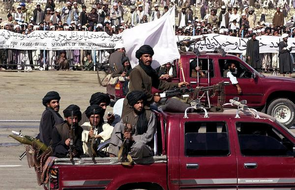Members of the Taliban militia ride in vehicles during Afghanistan's annual Independence Day parade in Kabul on Aug. 19, 2001. Afghanistan was largely cut off from the world during the Taliban's rule from 1996 to 2001. That changed dramatically after the Sept. 11 attacks.