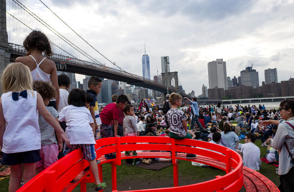 People gather to watch the Macy's Fourth of July fireworks show from Brooklyn Bridge Park, one of the newer developments along the East River, in 2015.