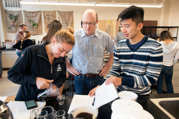Associate professor William Ristenpart talks with Sabrina Perell, a community regional development major, and Kyle Phan, an undeclared major, about the taste of their brew during the Design of Coffee class last October at UC Davis. Students learn the science of coffee, from roasting to brewing.
