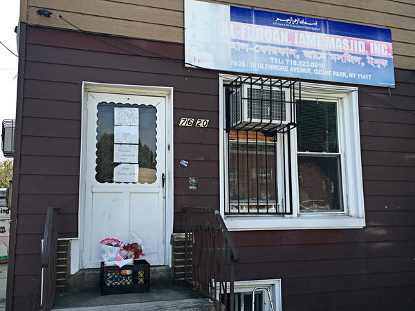 "Bangladeshi imam Maulama Akonjee and an associate were shot from behind on a busy street on a Saturday afternoon. Signs reading ""Rest in Peace"" adorn the door of Al-Furqan Jame Masjid, where Akonjee was the imam, in Ozone Park, Queens."