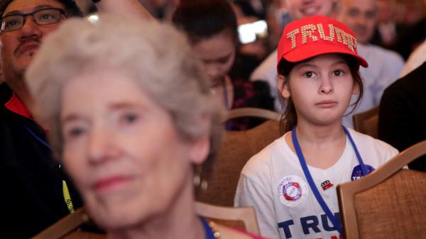 A young girl listens to Republican presidential candidate Donald Trump address the Values Voter Summit on September 9 in Washington, DC.