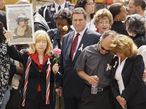 Sally Regenhard (left) holds a photo of her son, Christian, during a commemoration ceremony for Sept. 11 victims in New York City in 2008.