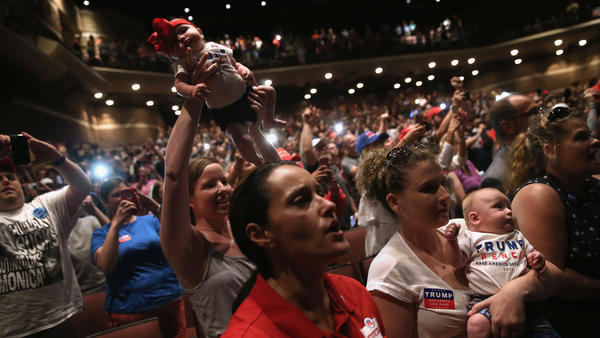 Women hold up their babies for Republican presidential nominee Donald Trump as he speaks at a campaign rally on Aug. 1 in Mechanicsburg, Pa.